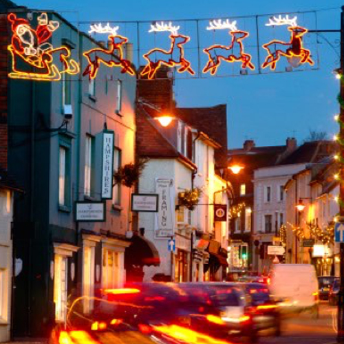 Photo of West Street in Dorking at dusk with Christmas lights